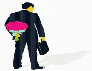 Businessman with briefcase hiding bouquet of flowers behind back
